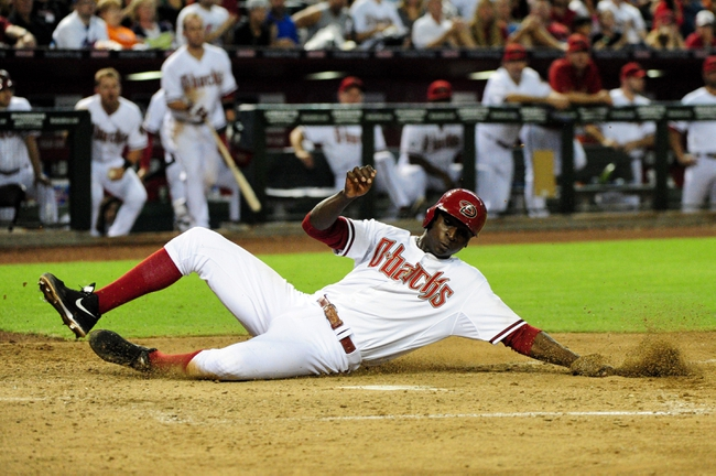 Jul 22, 2013; Phoenix, AZ, USA;  Arizona Diamondbacks shortstop Didi Gregorius (1) slides to score on a sacrifice fly by third baseman Martin Prado (14) during the sixth inning against the Chicago Cubs at Chase Field. Mandatory Credit: Matt Kartozian-USA TODAY Sports