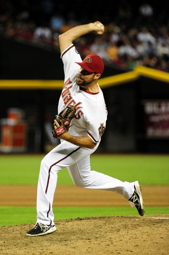 Jul 22, 2013; Phoenix, AZ, USA;  Arizona Diamondbacks relief pitcher Josh Collmenter (55) throws during seventh inning against the Chicago Cubs at Chase Field. Mandatory Credit: Matt Kartozian-USA TODAY Sports