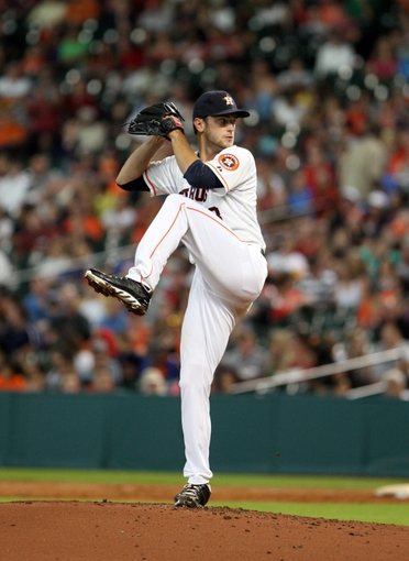 Jul 23, 2013; Houston, TX, USA; Houston Astros starting pitcher Jarred Cosart (48) delivers a pitch during the second inning against the Oakland Athletics at Minute Maid Park. Mandatory Credit: Troy Taormina-USA TODAY Sports