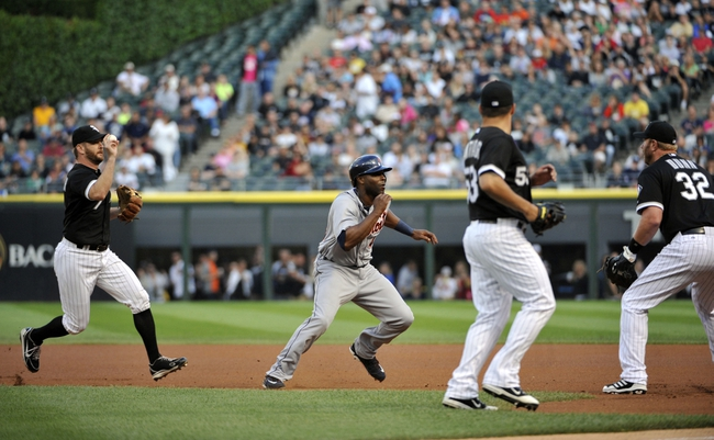Jul 23, 2013; Chicago, IL, USA; Detroit Tigers right fielder Torii Hunter (48) gets caught in a rundown between Chicago White Sox second baseman Jeff Keppinger (7) and first baseman Adam Dunn (32) during the first inning at U.S Cellular Field. Mandatory Credit: David Banks-USA TODAY Sports