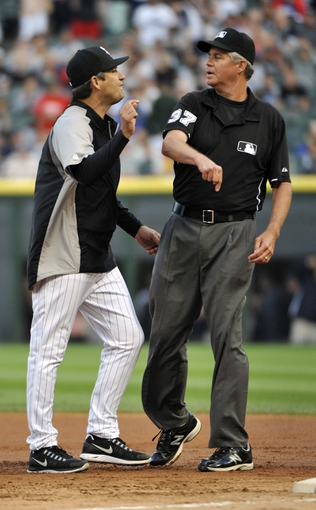 Jul 23, 2013; Chicago, IL, USA;  Chicago White Sox manager Robin Ventura (23) gets thrown out of the game after argueing a call with umpire Gary Darling (37) during the first inning of a game against the Detroit Tigers at U.S Cellular Field. Mandatory Credit: David Banks-USA TODAY Sports