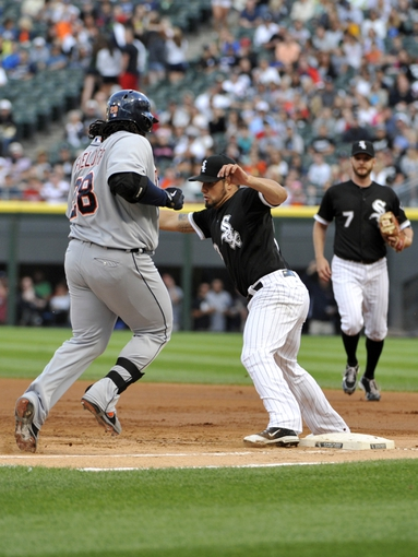 Jul 23, 2013; Chicago, IL, USA;  Chicago White Sox starting pitcher Hector Santiago (53) forces out Detroit Tigers first baseman Prince Fielder (28) during the first inning at U.S Cellular Field. Mandatory Credit: David Banks-USA TODAY Sports