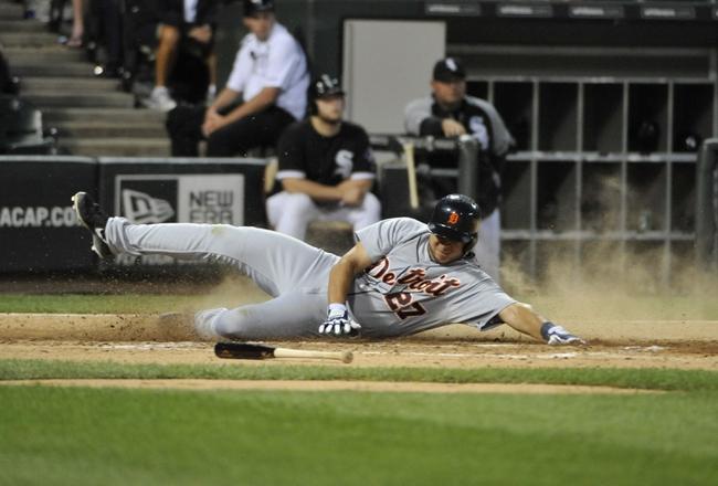 Jul 23, 2013; Chicago, IL, USA;  Detroit Tigers shortstop Jhonny Peralta (27) scores against the Chicago White Sox during the fourth inning at U.S Cellular Field. Mandatory Credit: David Banks-USA TODAY Sports