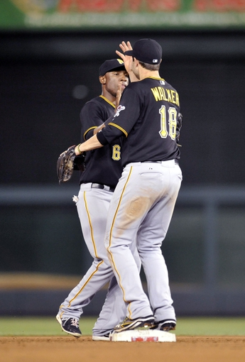 Jul 23, 2013; Washington, DC, USA; Pittsburgh Pirates teammates Starling Marte (left) and Neil Walker (right) celebrate after a game against the Washington Nationals at Nationals Park. The Pirates defeated the Nationals 5-1. Mandatory Credit: Joy R. Absalon-USA TODAY Sports
