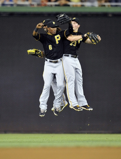 Jul 23, 2013; Washington, DC, USA; Pittsburgh Pirates outfielders Starling Marte (left), Travis Snider (right) and  Andrew McCutchen (back) celebrate after a game against the Washington Nationals at Nationals Park. The Pirates defeated the Nationals 5-1. Mandatory Credit: Joy R. Absalon-USA TODAY Sports