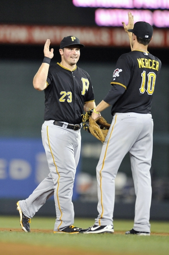 Jul 23, 2013; Washington, DC, USA; Pittsburgh Pirates teammates Travis Snider (23) and Jordy Mercer (10) celebrate after a game against the Washington Nationals at Nationals Park. The Pirates defeated the Nationals 5-1. Mandatory Credit: Joy R. Absalon-USA TODAY Sports