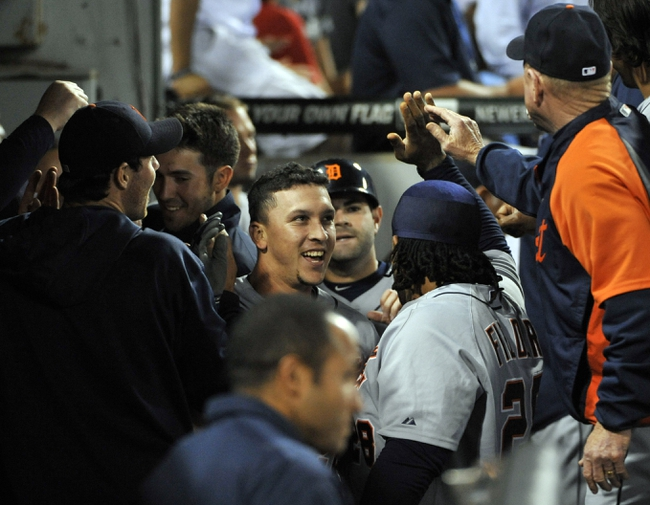 Jul 23, 2013; Chicago, IL, USA; Detroit Tigers shortstop Hernan Perez (26) is greeted by his teammates after hitting an RBI triple and scoring on an error against the Chicago White Sox during the sixth inning at U.S Cellular Field. Mandatory Credit: David Banks-USA TODAY Sports