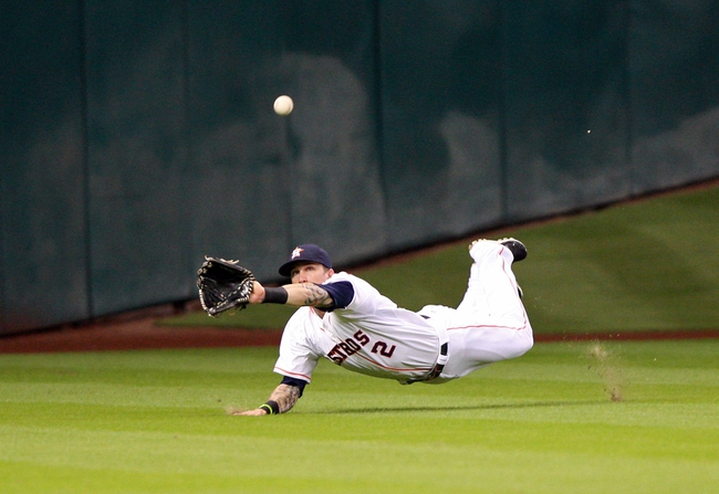 Jul 23, 2013; Houston, TX, USA; Houston Astros center fielder Brandon Barnes (2) dives for a fly ball during the fourth inning against the Oakland Athletics  at Minute Maid Park. Mandatory Credit: Troy Taormina-USA TODAY Sports