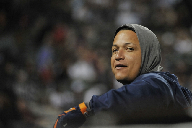 Jul 23, 2013; Chicago, IL, USA; Detroit Tigers third baseman Miguel Cabrera (24) watches the game from the dugout against the Chicago White Sox at U.S Cellular Field. Mandatory Credit: David Banks-USA TODAY Sports