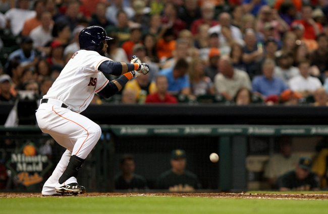 Jul 23, 2013; Houston, TX, USA; Houston Astros shortstop Jonathan Villar (6) moves a runner with a sacrifice bunt during the fifth inning against the Oakland Athletics at Minute Maid Park. Mandatory Credit: Troy Taormina-USA TODAY Sports