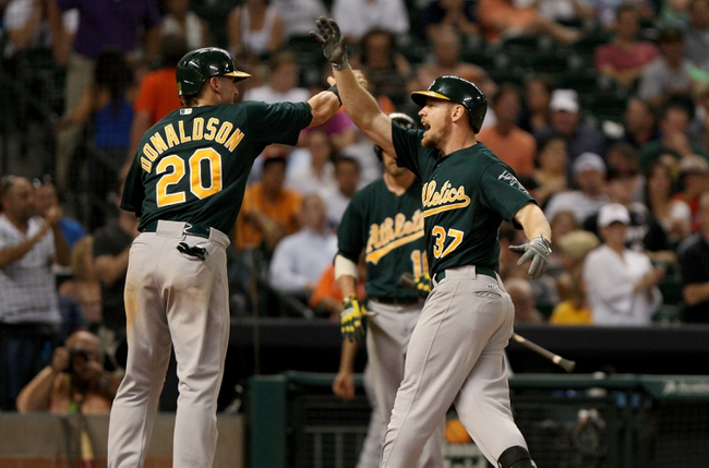 Jul 23, 2013; Houston, TX, USA; Oakland Athletics first baseman Brandon Moss (37) is congratulated by Josh Donaldson (20) after hitting a home run during the eighth inning against the Houston Astros at Minute Maid Park. Mandatory Credit: Troy Taormina-USA TODAY Sports