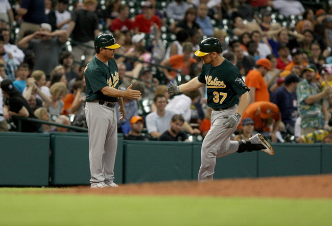 Jul 23, 2013; Houston, TX, USA; Oakland Athletics first baseman Brandon Moss (37) is congratulated by third base coach Mike Gallego (2) after hitting a home run during the eighth inning against the Houston Astros at Minute Maid Park. Mandatory Credit: Troy Taormina-USA TODAY Sports