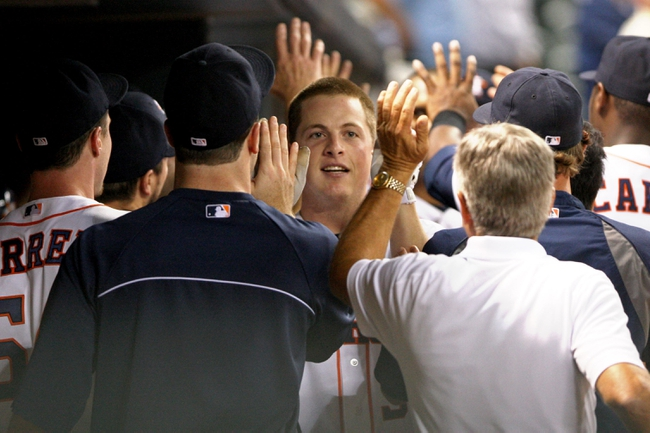 Jul 23, 2013; Houston, TX, USA; Houston Astros third baseman Matt Dominguez (30) is congratulated after hitting a home run during the ninth inning against the Oakland Athletics at Minute Maid Park. Mandatory Credit: Troy Taormina-USA TODAY Sports