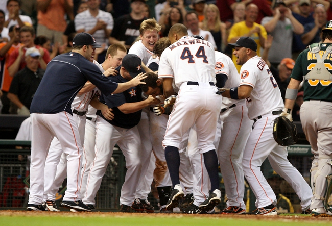 Jul 23, 2013; Houston, TX, USA; Members of the Houston Astros celebrate after defeating the Oakland Athletics 5-4 at Minute Maid Park. Mandatory Credit: Troy Taormina-USA TODAY Sports