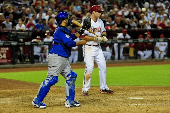 Jul 23, 2013; Phoenix, AZ, USA; Chicago Cubs catcher Dioner Navarro (30) catches the ball during an intentional walk of Arizona Diamondbacks first baseman Paul Goldschmidt (44) during the seventh inning at Chase Field. Mandatory Credit: Matt Kartozian-USA TODAY Sports