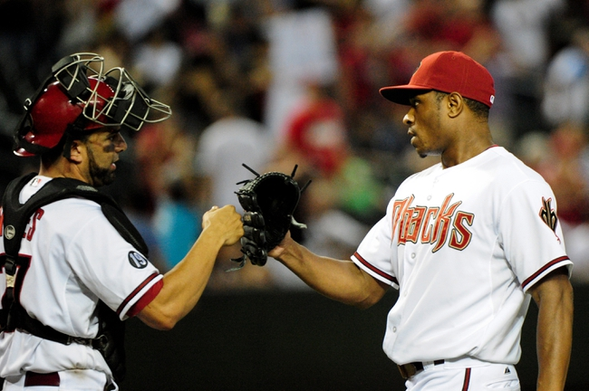 Jul 23, 2013; Phoenix, AZ, USA; Arizona Diamondbacks relief pitcher Tony Sipp (right) celebrates with catcher Wil Nieves (27) after beating the Chicago Cubs 10-4 at Chase Field. Mandatory Credit: Matt Kartozian-USA TODAY Sports