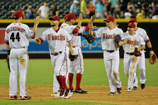 Jul 23, 2013; Phoenix, AZ, USA; Members of the Arizona Diamondbacks celebrate after beating the Chicago Cubs 10-4 at Chase Field. Mandatory Credit: Matt Kartozian-USA TODAY Sports