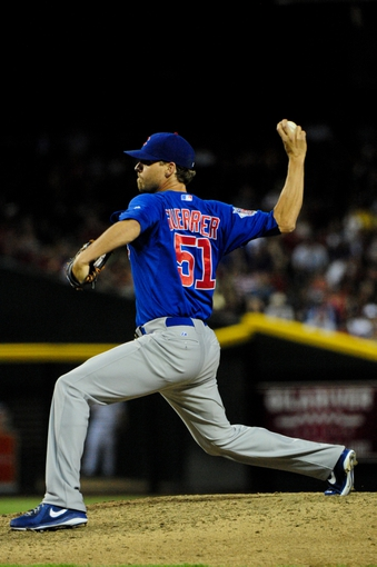 Jul 23, 2013; Phoenix, AZ, USA; Chicago Cubs relief pitcher Matt Guerrier (51) throws during the seventh inning against the Arizona Diamondbacks at Chase Field. Mandatory Credit: Matt Kartozian-USA TODAY Sports