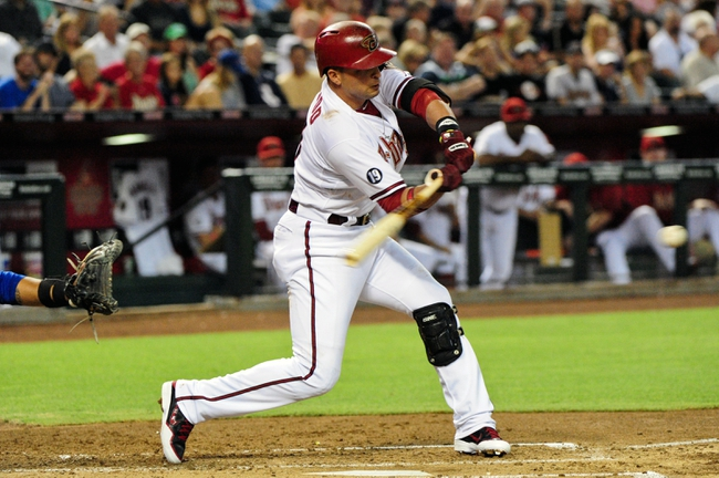 Jul 23, 2013; Phoenix, AZ, USA; Arizona Diamondbacks third baseman Martin Prado (14) at bat during the second inning against the Chicago Cubs at Chase Field. Mandatory Credit: Matt Kartozian-USA TODAY Sports