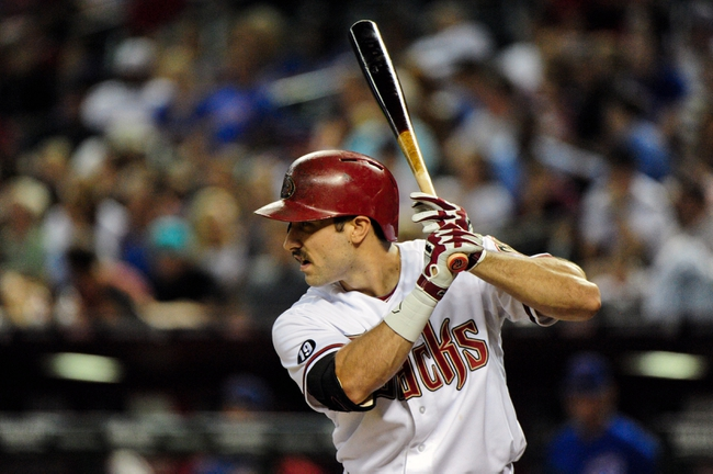 Jul 23, 2013; Phoenix, AZ, USA; Arizona Diamondbacks left fielder Adam Eaton (6) at bat during the fourth inning against the Chicago Cubs at Chase Field. Mandatory Credit: Matt Kartozian-USA TODAY Sports