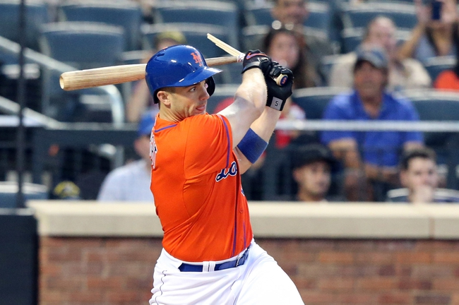 Jul 24, 2013; New York, NY, USA;   New York Mets third baseman David Wright (5) is hit in the head by his broken bat during the fourth inning against the Atlanta Braves at Citi Field Mandatory Credit: Anthony Gruppuso-USA TODAY Sports