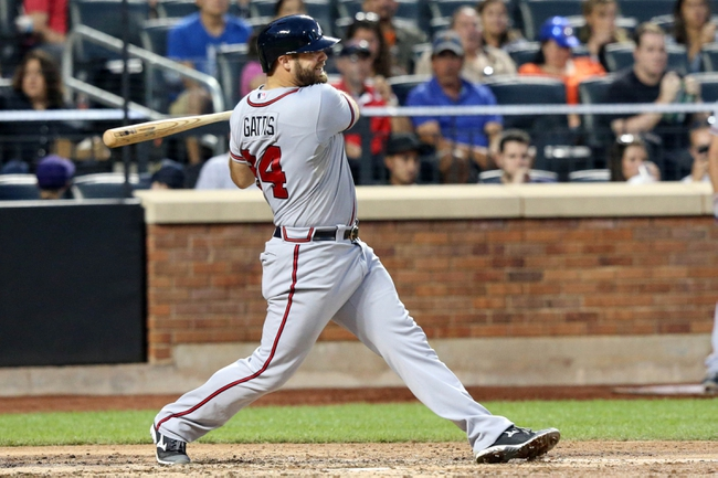 Jul 24, 2013; New York, NY, USA; Atlanta Braves catcher Evan Gattis (24) singles to left during the fifth inning against the New York Mets at Citi Field Mandatory Credit: Anthony Gruppuso-USA TODAY Sports