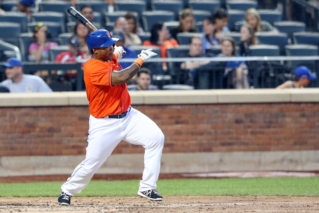 Jul 24, 2013; New York, NY, USA;  New York Mets right fielder Marlon Byrd (6) reaches on an infield single to the shortstop during the fourth inning against the Atlanta Braves at Citi Field Mandatory Credit: Anthony Gruppuso-USA TODAY Sports