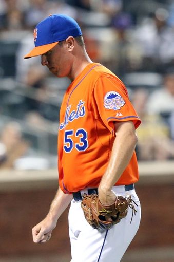 Jul 24, 2013; New York, NY, USA;  New York Mets starting pitcher Jeremy Hefner (53) heads to the dugout after being relieved during the fifth inning against the Atlanta Braves at Citi Field Mandatory Credit: Anthony Gruppuso-USA TODAY Sports