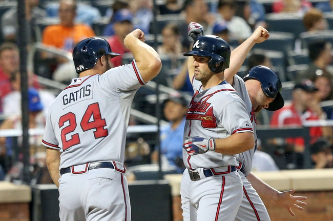 Jul 24, 2013; New York, NY, USA;   Atlanta Braves second baseman Dan Uggla (26) celebrates his three run home run with catcher Evan Gattis (24) and catcher Brian McCann (16) during the fifth inning against the New York Mets at Citi Field Mandatory Credit: Anthony Gruppuso-USA TODAY Sports