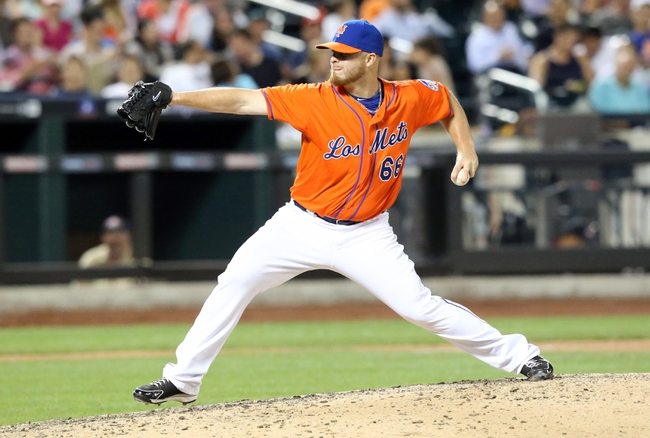Jul 24, 2013; New York, NY, USA;  New York Mets relief pitcher Josh Edgin (66) delivers a pitch during the eighth inning against the Atlanta Braves at Citi Field. Mandatory Credit: Anthony Gruppuso-USA TODAY Sports