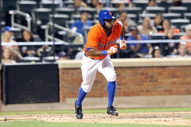 Jul 24, 2013; New York, NY, USA;  New York Mets left fielder Eric Young Jr. (22) heads to first base during the eighth inning and collides with Atlanta Braves starting pitcher Tim Hudson (not pictured) at Citi Field. Mandatory Credit: Anthony Gruppuso-USA TODAY Sports