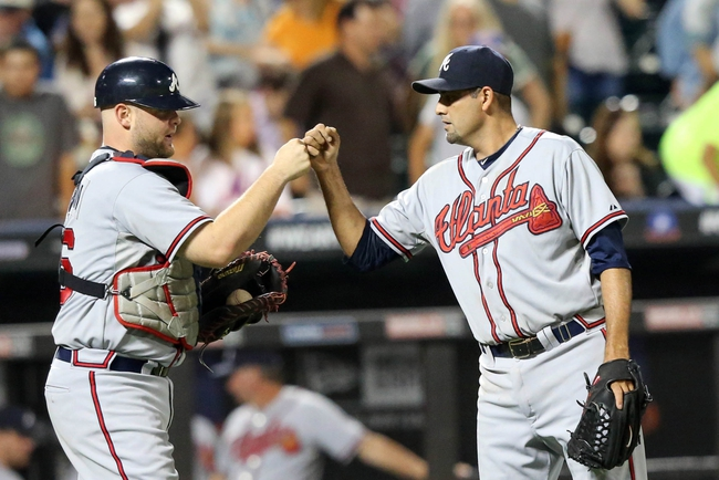 Jul 24, 2013; New York, NY, USA;  Atlanta Braves relief pitcher Luis Ayala (20) and catcher Brian McCann (16) celebrate the win against the New York Mets at Citi Field Braves won 8-2.  Mandatory Credit: Anthony Gruppuso-USA TODAY Sports