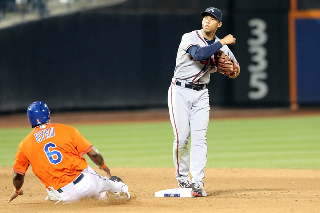 Jul 24, 2013; New York, NY, USA;  Atlanta Braves shortstop Andrelton Simmons (19) completes the double play as New York Mets right fielder Marlon Byrd (6) is out at second during the ninth inning at Citi Field Braves won 8-2.  Mandatory Credit: Anthony Gruppuso-USA TODAY Sports