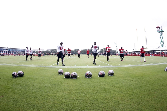 Jul 25, 2013; Tampa, FL, USA; Tampa Bay Buccaneers wide receiver Derek Hagan (18), wide receiver Carlton Mitchell (12), corner back Johnthan Banks (27) , free safety Ahmad Black (43) and teammates work out during training camp at One Buccaneer Place. Mandatory Credit: Kim Klement-USA TODAY Sports