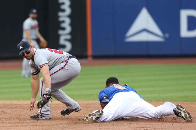 Jul 25, 2013; New York, NY, USA;  New York Mets right fielder Marlon Byrd (6) advances to second base past the tag of Atlanta Braves second baseman Dan Uggla (26) during the third inning at Citi Field. Mandatory Credit: Anthony Gruppuso-USA TODAY Sports