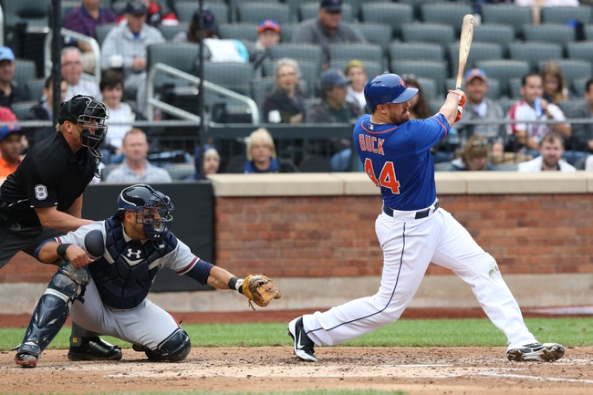Jul 25, 2013; New York, NY, USA;  New York Mets catcher John Buck (44) singles to left allowing two runners to score during the third inning against the Atlanta Braves at Citi Field. Mandatory Credit: Anthony Gruppuso-USA TODAY Sports