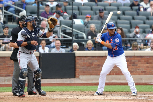 Jul 25, 2013; New York, NY, USA; New York Mets center fielder Juan Lagares (12) is intentionally walked during the third inning against the Atlanta Braves at Citi Field. Mandatory Credit: Anthony Gruppuso-USA TODAY Sports