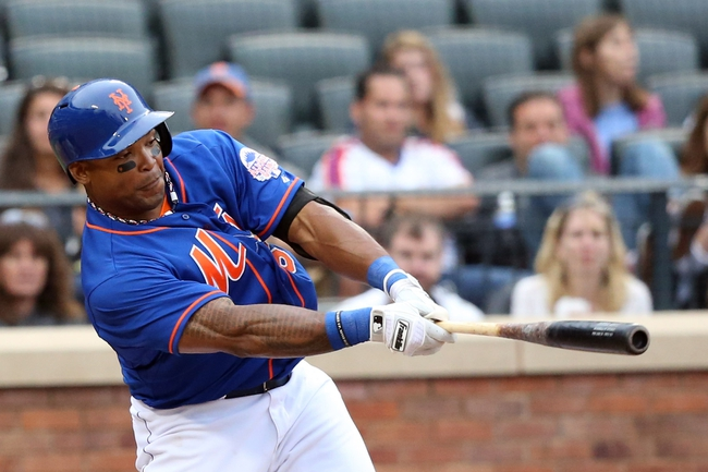 Jul 25, 2013; New York, NY, USA;  New York Mets right fielder Marlon Byrd (6) singles to left allowing a runner to score during the third inning against the Atlanta Braves at Citi Field. Mandatory Credit: Anthony Gruppuso-USA TODAY Sports
