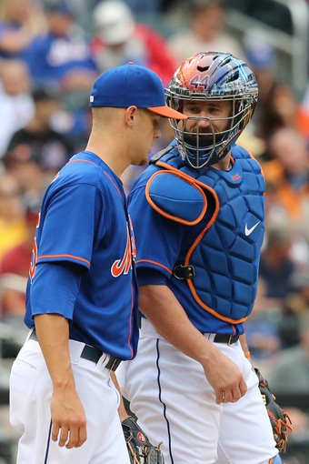 Jul 25, 2013; New York, NY, USA;  New York Mets catcher John Buck (44) talks with starting pitcher Zack Wheeler (45) during the fourth inning against the Atlanta Braves at Citi Field. Mandatory Credit: Anthony Gruppuso-USA TODAY Sports