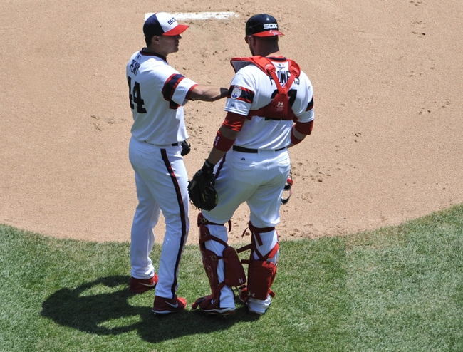 Jul 25, 2013; Chicago, IL, USA; Chicago White Sox starting pitcher Jake Peavy (44) talks with  catcher Tyler Flowers (21) during the first inning of a game against the Detroit Tigers at U.S. Cellular Field. Mandatory Credit: David Banks-USA TODAY Sports