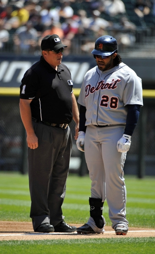 Jul 25, 2013; Chicago, IL, USA; Detroit Tigers first baseman Prince Fielder (28) argues a call with umpire Bruce Dreckman (1) in a game against the Chicago White Sox during the second inning at U.S. Cellular Field. Mandatory Credit: David Banks-USA TODAY Sports