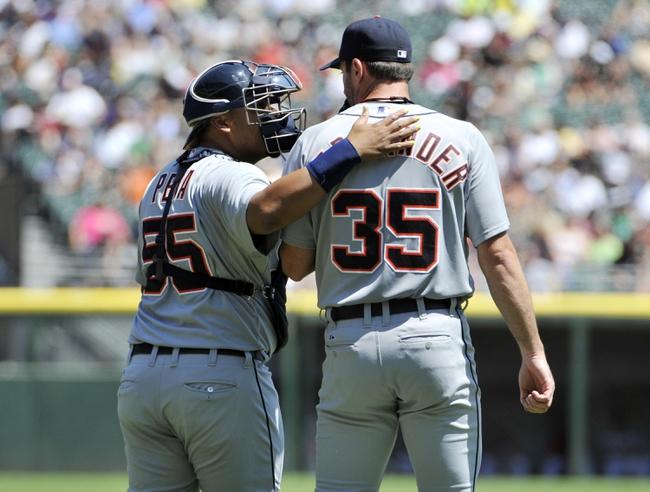 Jul 25, 2013; Chicago, IL, USA; Detroit Tigers catcher Brayan Pena (55) talks with starting pitcher Justin Verlander (35) during the second inning at U.S. Cellular Field. Mandatory Credit: David Banks-USA TODAY Sports