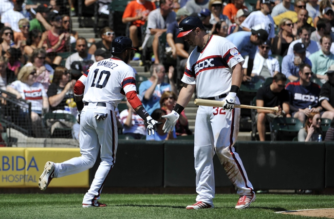 Jul 25, 2013; Chicago, IL, USA; Chicago White Sox shortstop Alexei Ramirez (10) is greeted after scoring by  first baseman Adam Dunn (32) during the fourth inning against the Detroit Tigers at U.S. Cellular Field. Mandatory Credit: David Banks-USA TODAY Sports
