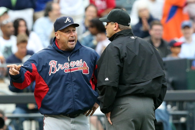 Jul 25, 2013; New York, NY, USA;   Atlanta Braves manager Fredi Gonzalez (33) argues with umpire Chad Fairchild (75) before being ejected during the sixth inning against the New York Mets at Citi Field. Mets won 7-4.  Mandatory Credit: Anthony Gruppuso-USA TODAY Sports