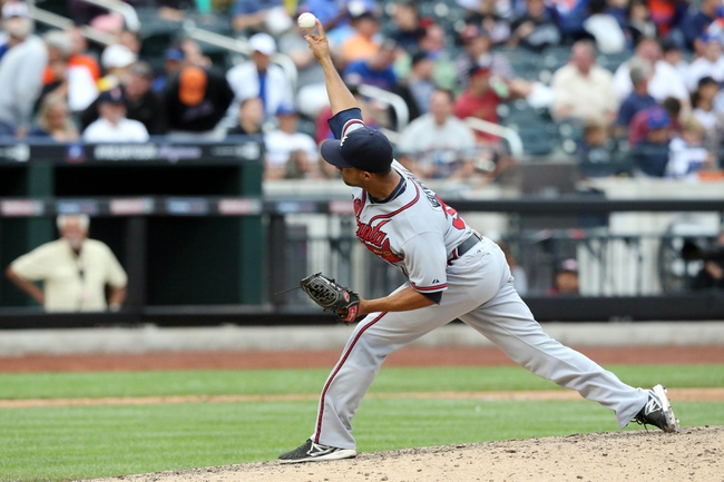 Jul 25, 2013; New York, NY, USA;   Atlanta Braves relief pitcher Anthony Varvaro (38) delivers a pitch during the seventh inning against the New York Mets at Citi Field. Mets won 7-4.  Mandatory Credit: Anthony Gruppuso-USA TODAY Sports