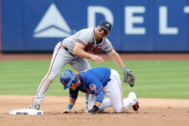 Jul 25, 2013; New York, NY, USA;  Atlanta Braves second baseman Dan Uggla (26) forces out New York Mets first baseman Justin Turner (2) during the eighth inning at Citi Field. Mets won 7-4.  Mandatory Credit: Anthony Gruppuso-USA TODAY Sports