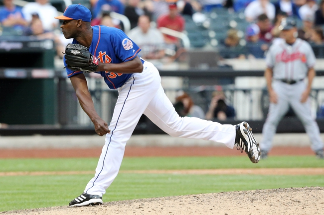 Jul 25, 2013; New York, NY, USA;  New York Mets relief pitcher LaTroy Hawkins (32) pitches during the eighth inning against the Atlanta Braves at Citi Field. Mets won 7-4.  Mandatory Credit: Anthony Gruppuso-USA TODAY Sports
