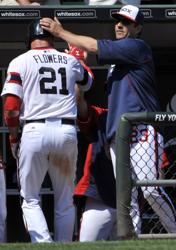 Jul 25, 2013; Chicago, IL, USA; Chicago White Sox catcher Tyler Flowers (21) is greeted by manager Robin Ventura (23) after hitting a home run against the Detroit Tigers during the sixth inning at U.S. Cellular Field. Mandatory Credit: David Banks-USA TODAY Sports