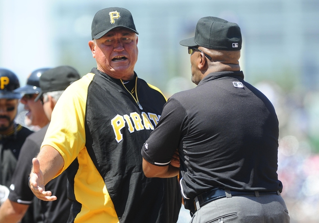 Jul 25, 2013; Washington, DC, USA; Pittsburgh Pirates manager Clint Hurdle argues with first base umpire Laz Diaz during the seventh inning against the Washington Nationals at Nationals Park.  Mandatory Credit: Brad Mills-USA TODAY Sports