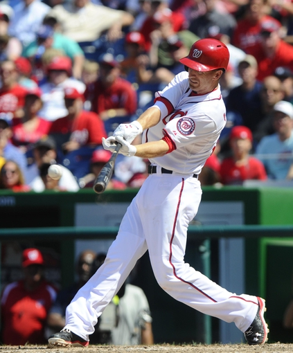 Jul 25, 2013; Washington, DC, USA; Washington Nationals first baseman Adam LaRoche (25) hits a two run RBI triple during the eighth inning against the Pittsburgh Pirates at Nationals Park. Mandatory Credit: Brad Mills-USA TODAY Sports